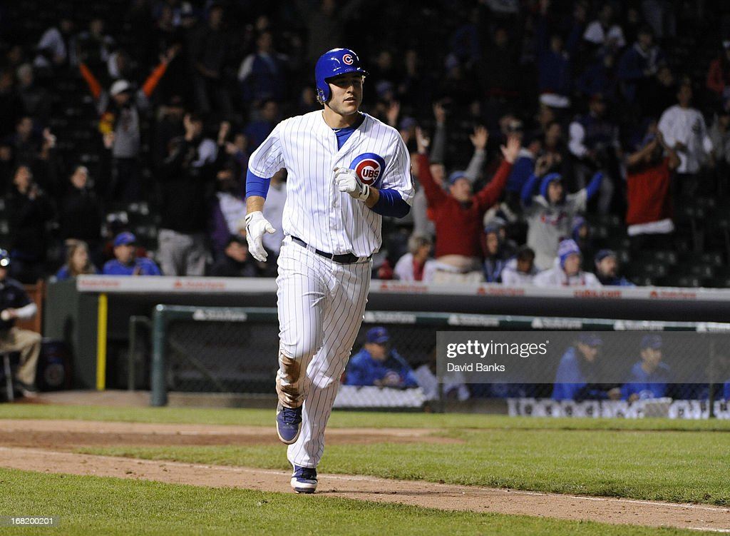 <a gi-track='captionPersonalityLinkClicked' href=/galleries/search?phrase=Anthony+Rizzo&family=editorial&specificpeople=7551494 ng-click='$event.stopPropagation()'>Anthony Rizzo</a> #44 of the Chicago Cubs runs the bases after hitting a two-run homer against the Texas Rangers during the eighth inning on May 6, 2013 at Wrigley Field in Chicago, Illinois. The Chicago Cubs defeated the Texas Rangers 9-2.