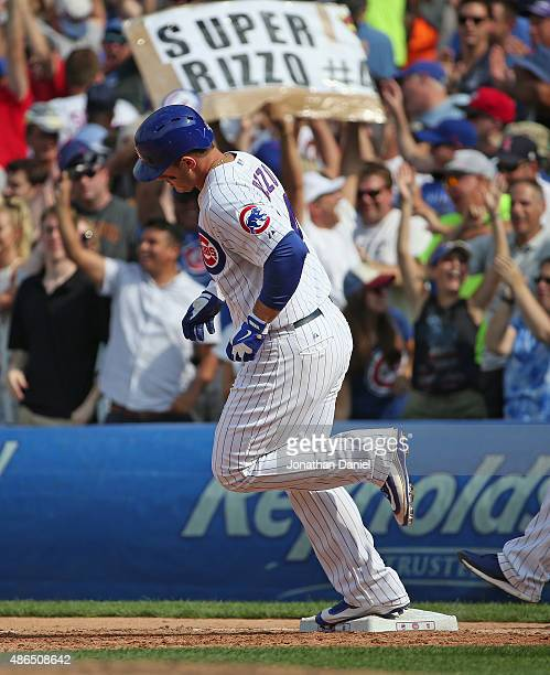 Anthony Rizzo of the Chicago Cubs runs the bases after hitting a grand slam home run in the 5th inning against the Arizona Diamondbacks at Wrigley...