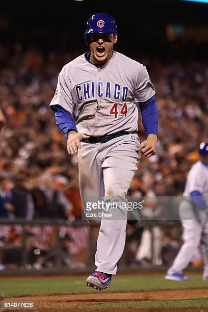 Anthony Rizzo of the Chicago Cubs scores in the eighth inning on a single by Willson Contreras in Game Four of their National League Division Series...