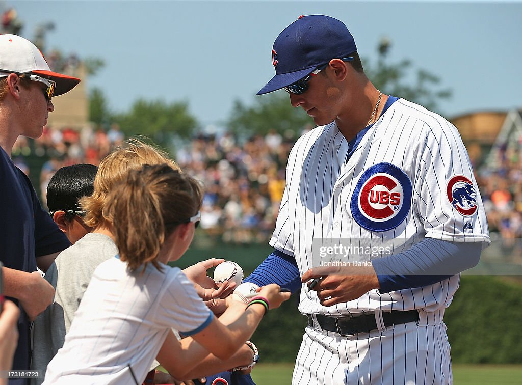 Anthony Rizzo #44 of the Chicago Cubs signs autographs before a game against the Pittsburgh Pirates at Wrigley Field on July 5, 2013 in Chicago, Illinois. The Pirates defeated the Cubs 6-2.