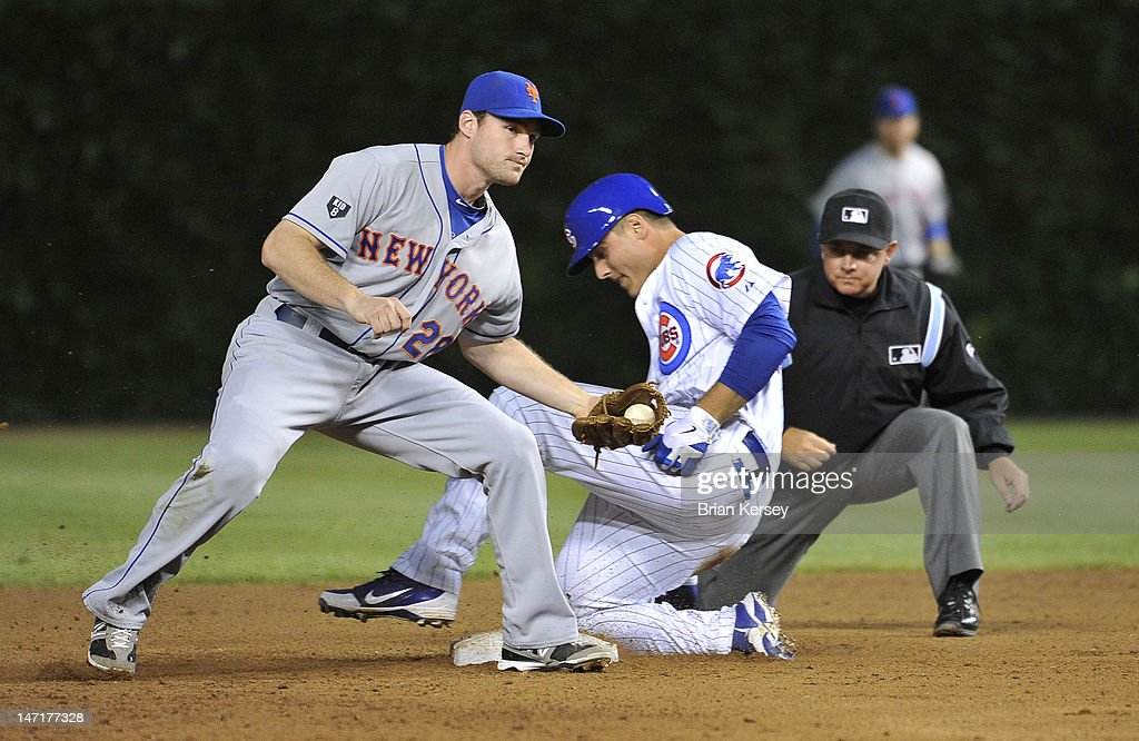 <a gi-track='captionPersonalityLinkClicked' href=/galleries/search?phrase=Anthony+Rizzo&family=editorial&specificpeople=7551494 ng-click='$event.stopPropagation()'>Anthony Rizzo</a> #44 of the Chicago Cubs (R) slides safely into second base after hitting an RBI double scoring teammate Steve Clevenger #51 as second baseman Daniel Murphy #28 of the New York Mets holds the ball during the fourth inning at Wrigley Field on June 26, 2012 in Chicago, Illinois.