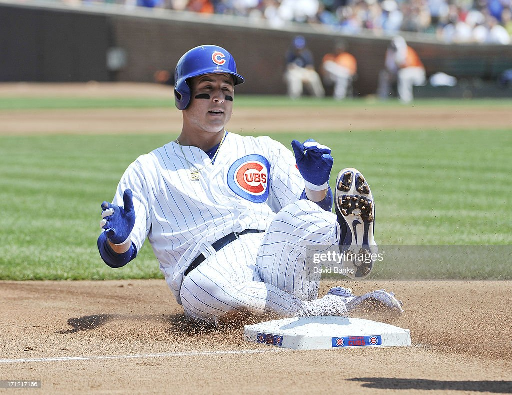 Anthony Rizzo #44 of the Chicago Cubs slides safely into third base against the Houston Astros during the second inning on June 23, 2013 at Wrigley Field in Chicago, Illinois.