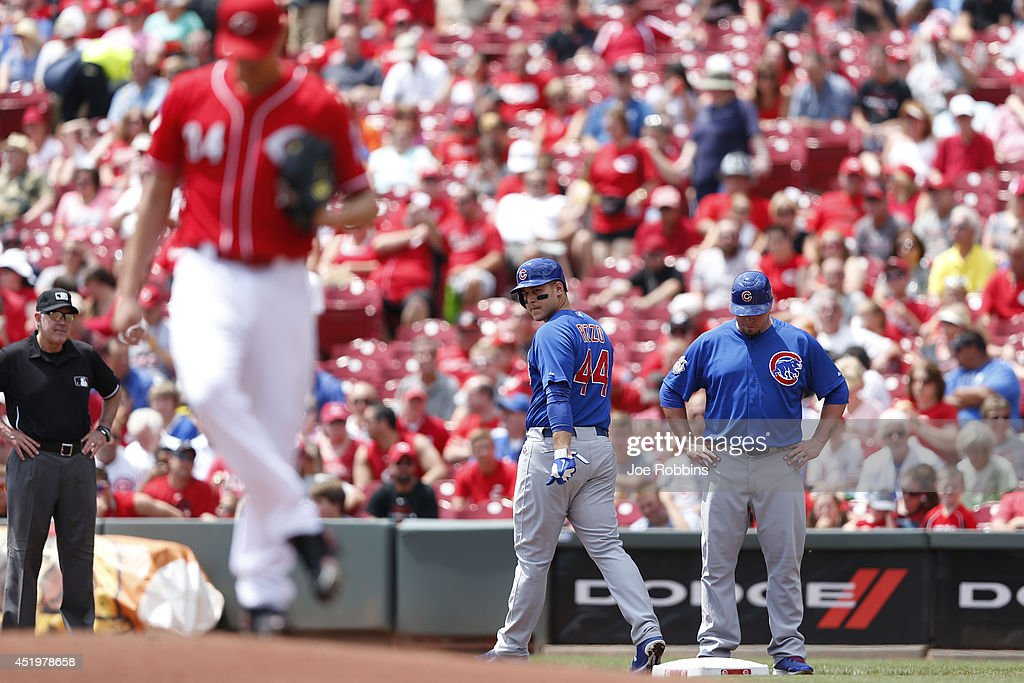 Anthony Rizzo #44 of the Chicago Cubs stares back at Homer Bailey #34 of the Cincinnati Reds after being hit by a pitch in the first inning of the game at Great American Ball Park on July 10, 2014 in Cincinnati, Ohio.