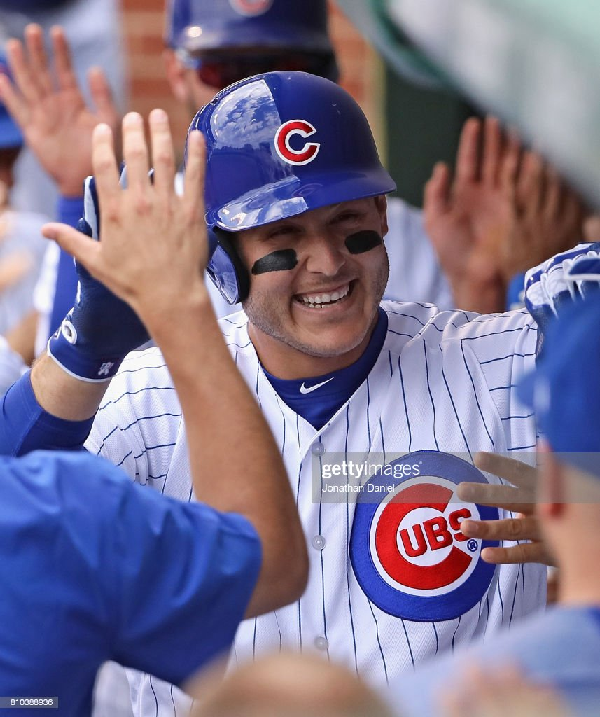Anthony Rizzo #44 of the Chicago Cubsis congratulated in the dugout after hitting a two run home run in the 4th inning against the Pittsburgh Pirates at Wrigley Field on July 7, 2017 in Chicago, Illinois.