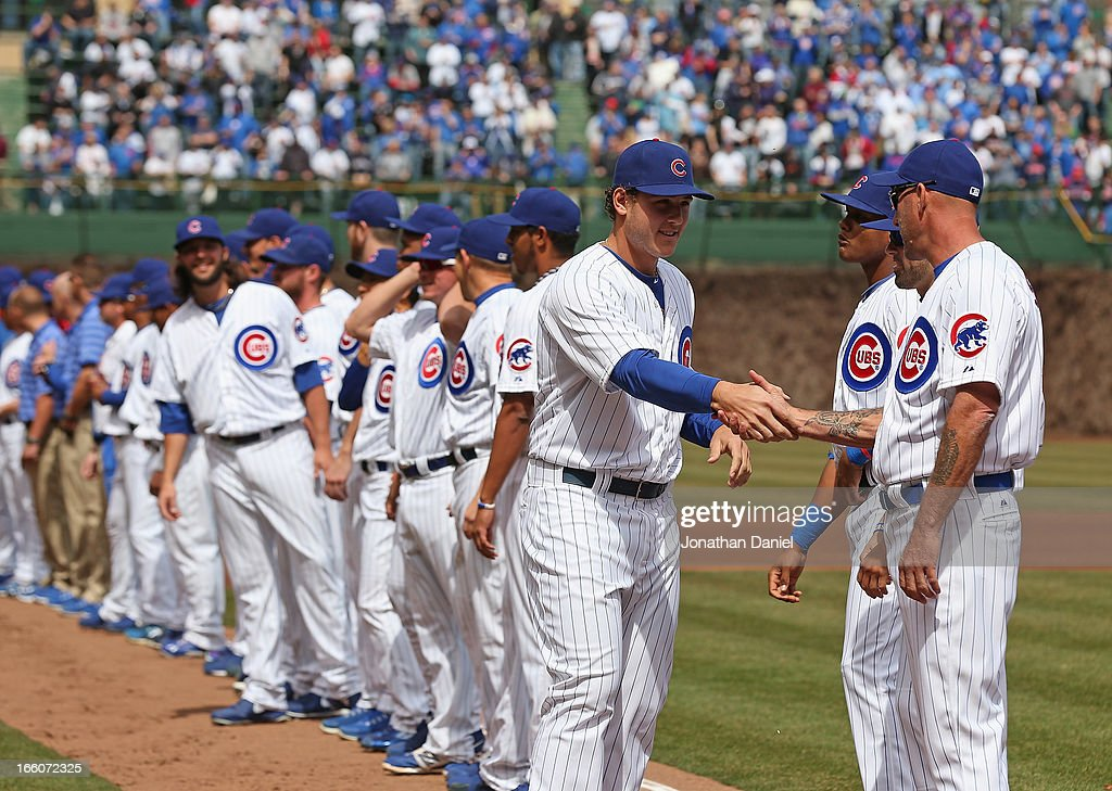 Anthony Rizzo#44 of the Chicago Cubs shakes hands with manager Dale Sveum #4 during player introductions before the Opening Day game against the Milwaukee Brewers at Wrigley Field on April 8, 2013 in Chicago, Illinois.