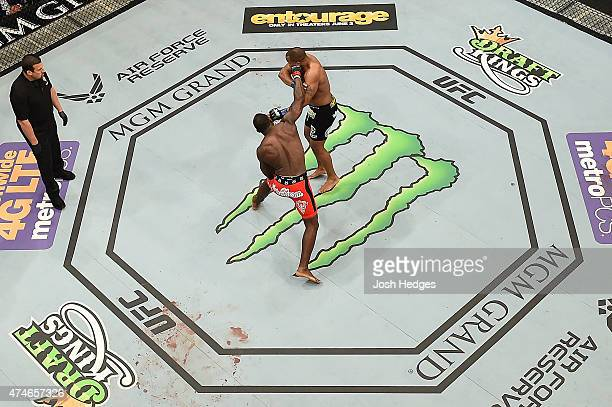 Anthony 'Rumble' Johnson punches Daniel Cormier in their UFC light heavyweight championship bout during the UFC 187 event at the MGM Grand Hotel...