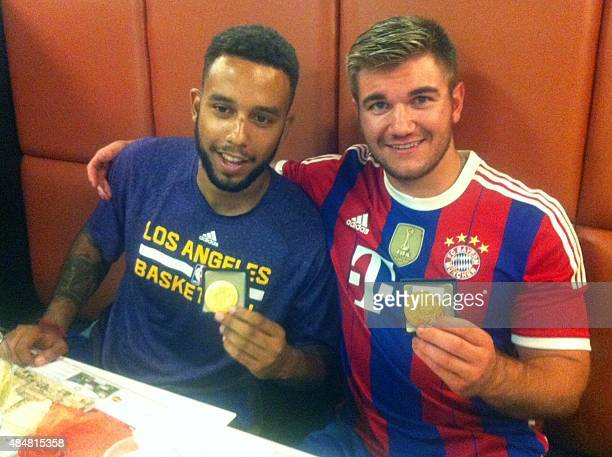 Anthony Sadler from Pittsburg California and Alek Skarlatos from Roseburg Oregon hold their medals as they sit in a restaurant after a brief ceremony...