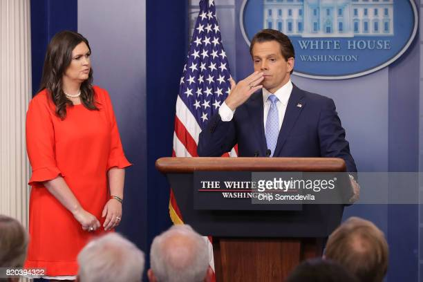 Anthony Scaramucci blows a kiss as he and White House Principal Deputy Press Secretary Sarah Huckabee Sanders conduct the daily White House press...