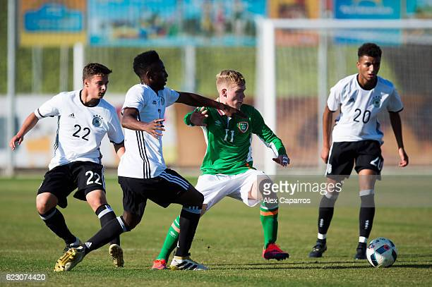 Anthony Scully of Ireland conducts the ball between MarvinLee Rittmuller Gabriel Kyeremateng and Timothy Tillman of Germany during the U18...