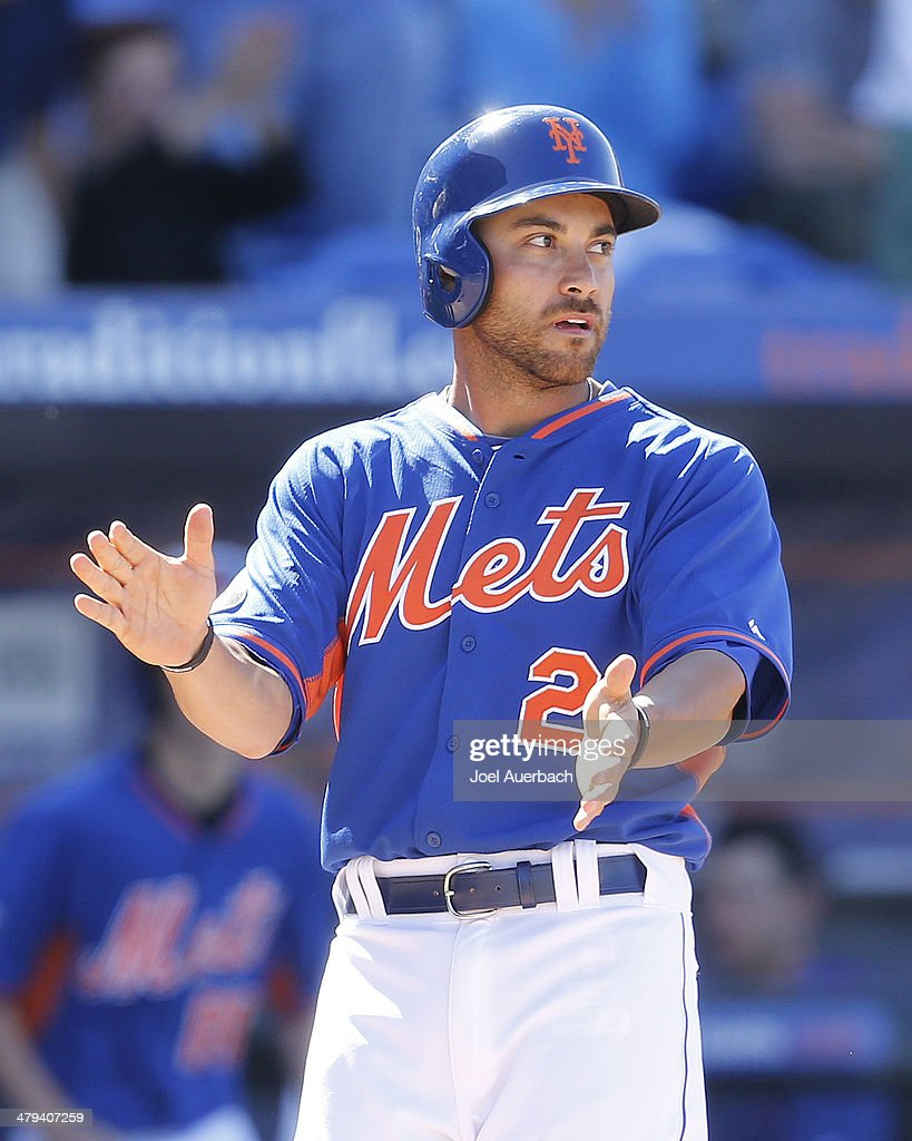 Anthony Seratelli #2 of the New York Mets claps his hands after scoring the winning run in the bottom of the ninth inning against the Detroit Tigers during a spring training game at Tradition Field on March 18, 2014 in Port St. Lucie, Florida. The Mets defeated the Tigers 5-4.