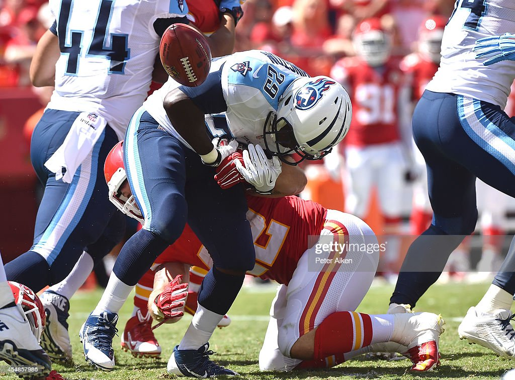 Anthony Sherman of the Kansas City Chiefs knocks the ball loose from Leon Washington of the Tennessee Titans for a fumble during the first half at...