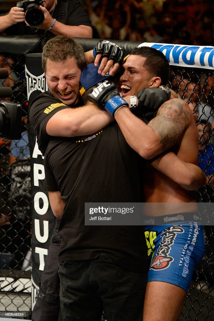 Anthony 'Showtime' Pettis celebrates with his coach Duke Roufus after defeating Benson Henderson in their UFC lightweight championship bout at BMO...