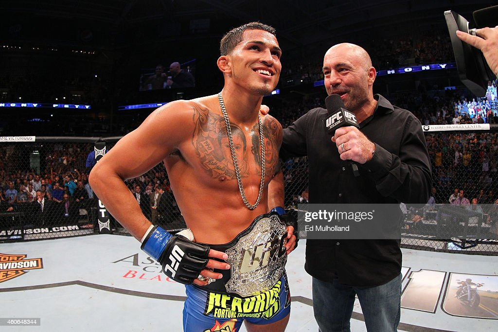 Anthony 'Showtime' Pettis talks with UFC playbyplay broadcaster Joe Rogan after defeating Benson henderson in their UFC lightweight championship bout...