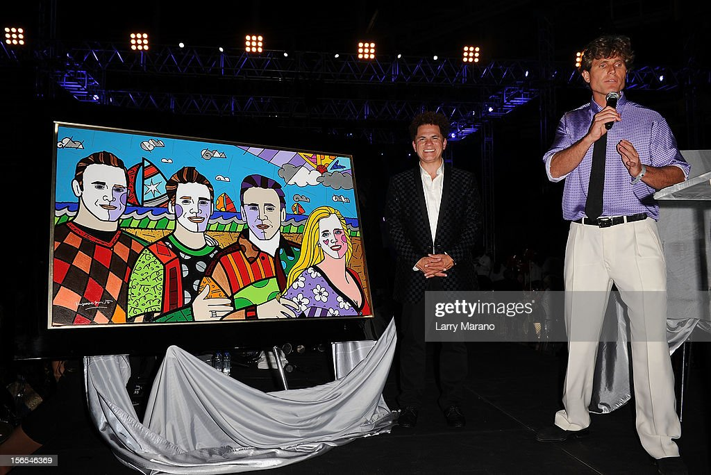 Anthony Shriver (R) is joined onstage by artist Romero Britto at the Zenith Watches Best Buddies Miami Gala at Marlins Park on November 16, 2012 in Miami, Florida.