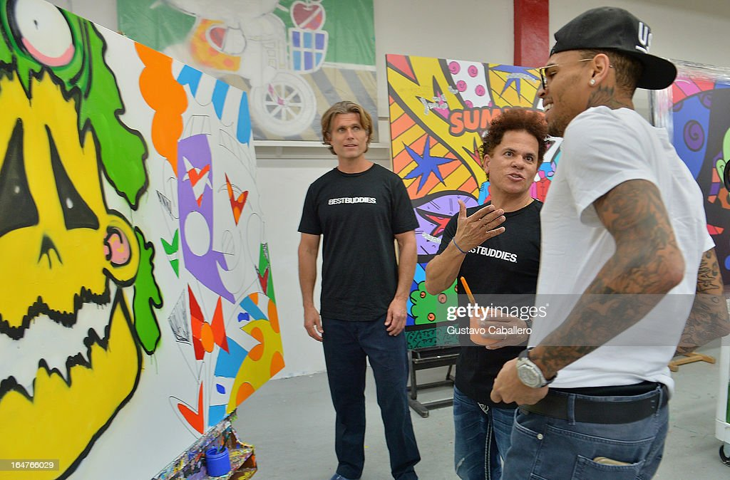 Anthony Shriver, Romero Britto and Chris Brown attend the Chris Brown joins forces with artist Romero Britto in support of Best Buddies International event on March 27, 2013 in Miami, Florida.