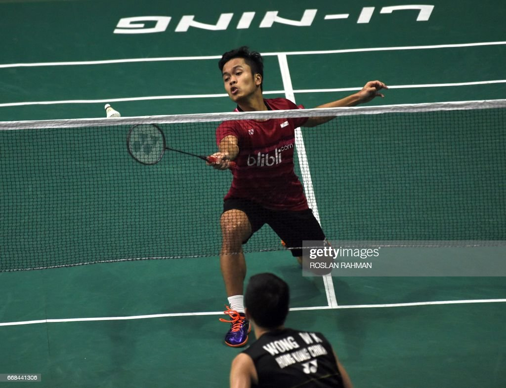 Anthony Sinisuka Ginting of Indonesia plays a shot against Vincent