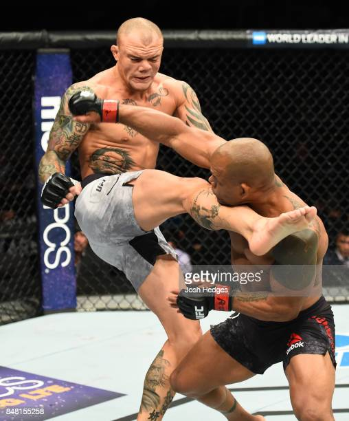 Anthony Smith kicks Hector Lombard of Cuba in their middleweight bout during the UFC Fight Night event inside the PPG Paints Arena on September 16...