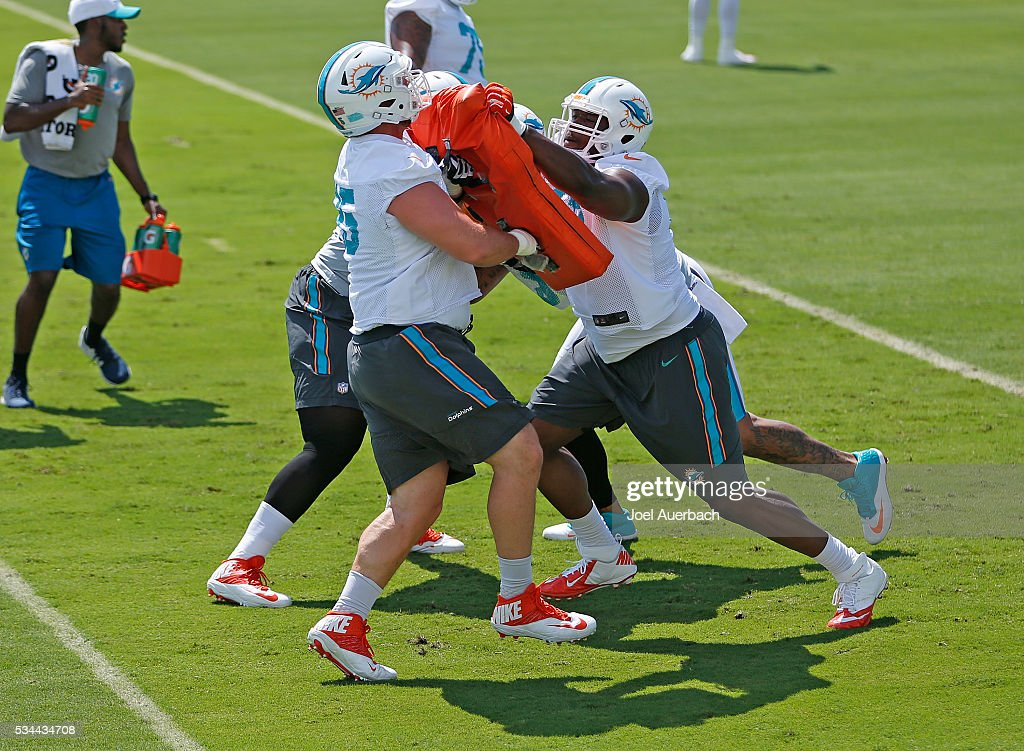 Anthony Steen #65 and <a gi-track='captionPersonalityLinkClicked' href=/galleries/search?phrase=Laremy+Tunsil&family=editorial&specificpeople=11377896 ng-click='$event.stopPropagation()'>Laremy Tunsil</a> #67 of the Miami Dolphins run a drill during the team's OTA's on May 26, 2016 at the Miami Dolphins training facility in Davie, Florida.