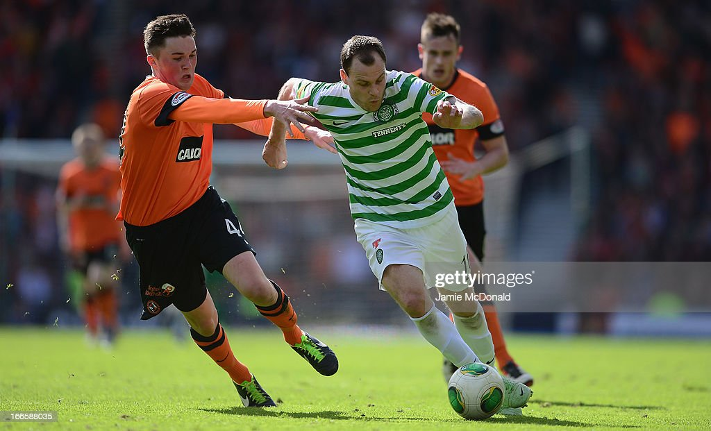 <a gi-track='captionPersonalityLinkClicked' href=/galleries/search?phrase=Anthony+Stokes&family=editorial&specificpeople=3772397 ng-click='$event.stopPropagation()'>Anthony Stokes</a> of Celtic battles with Mark Millar of Dundee United during The William Hill Scottish Cup Semi Final between Dundee United and Celtic at Hampden Park on April 14, 2013 in Glasgow, United Kingdom.