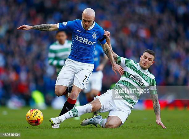Anthony Stokes of Celtic tackles Nicky Law of Rangers during the Scottish League Cup SemiFinal between Celtic and Rangers at Hampden Park on February...