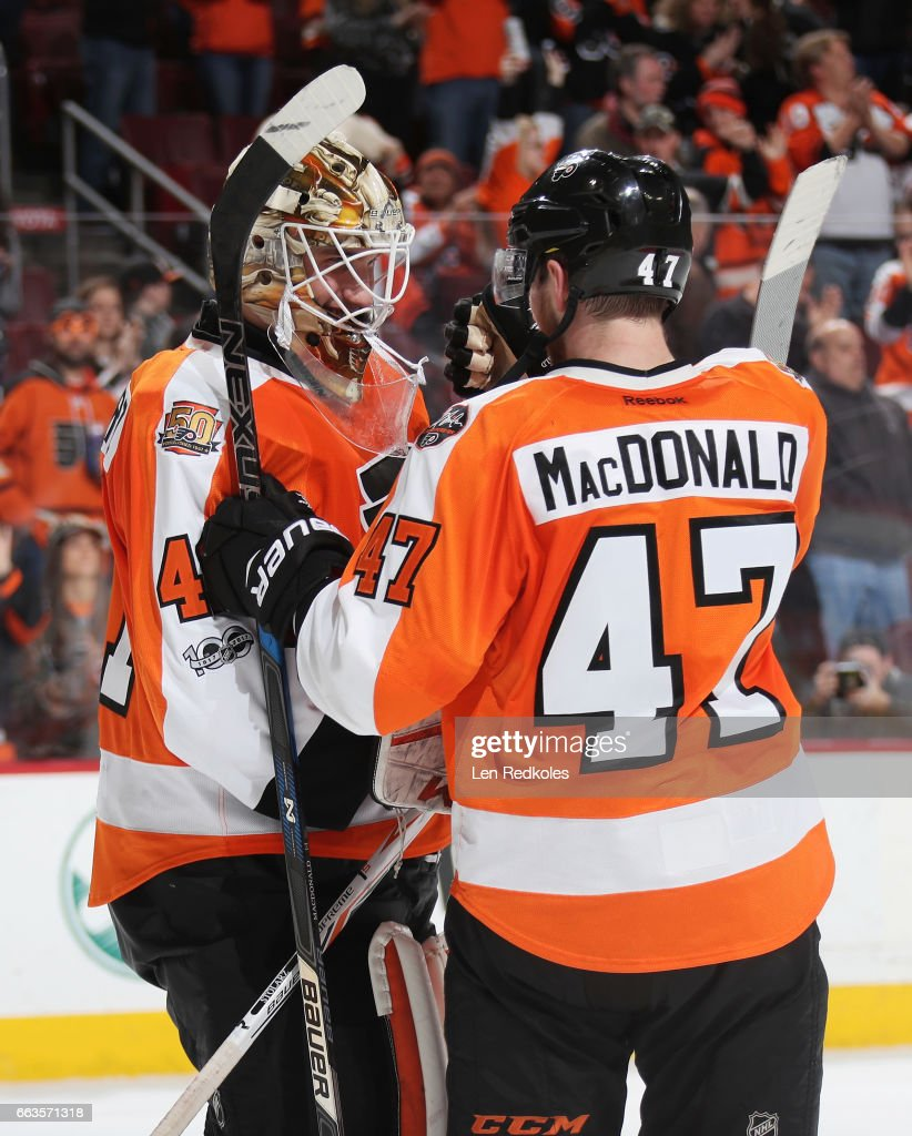 a04c5bcb2 ... Jerseys Anthony Stolarz 41 and Andrew MacDonald 47 of the Philadelphia  Flyers celebrate after defeating ...