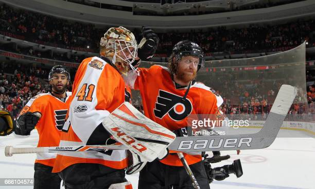 Anthony Stolarz Jakub Voracek and PierreEdouard Bellemare of the Philadelphia Flyers celebrate after defeating the New Jersey Devils 30 on April 1...