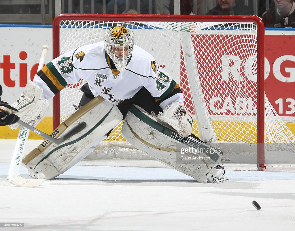 <a gi-track='captionPersonalityLinkClicked' href=/galleries/search?phrase=Anthony+Stolarz&family=editorial&specificpeople=9480785 ng-click='$event.stopPropagation()'>Anthony Stolarz</a> #43 of the London Knights keeps an eye on the puck against the Sault Ste. Marie Greyhounds during an OHL game at the Budweiser Gardens on December 4, 2013 in London, Ontario, Canada. The Knights defeated the Greyhounds 3-2.