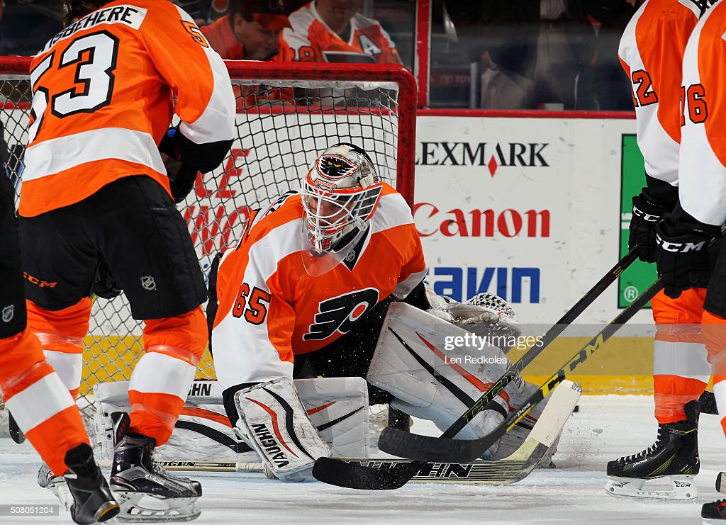 Anthony Stolarz #65 of the Philadelphia Flyers covers the net during the warm-ups prior to the game against the Montreal Canadiens on February 2, 2016 at the Wells Fargo Center in Philadelphia, Pennsylvania.