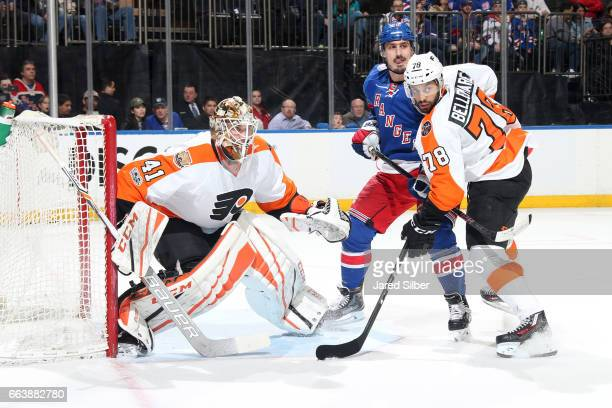Anthony Stolarz of the Philadelphia Flyers tends the net as PierreEdouard Bellemare defends against Chris Kreider of the New York Rangers at Madison...
