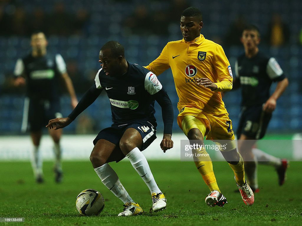 Anthony Straker of Southend United avoids Tyrone Marsh of Oxford United after scoring during the Johnstone's Paint Trophy Southern Section Semi Final between Oxford United and Southend United at the Kassam Stadium on January 8, 2013 in Oxford, England.