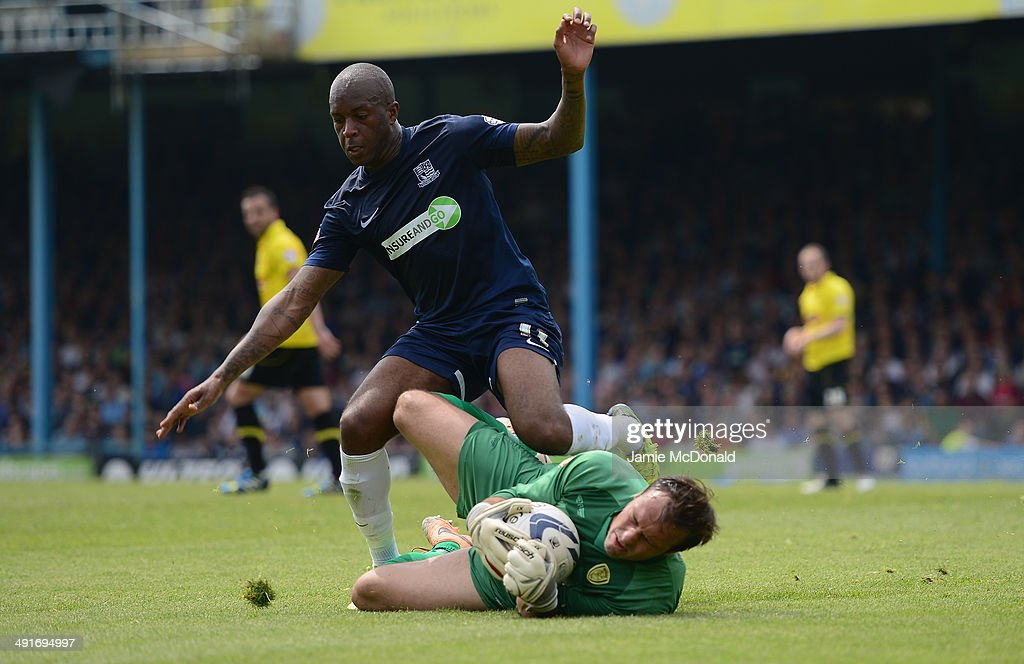 Anthony Straker of Southend United battles with Dean Lyness of Burton Albion during the Sky Bet League Two semi-final, second leg match between Southend United and Burton Albion at Roots Hall on May 17, 2014 in Southend, England.
