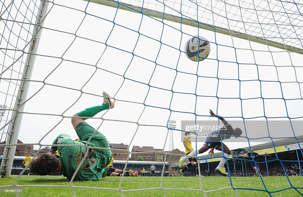 Anthony Straker of Southend United scores his goal during the Sky Bet League Two semi-final, second leg match between Southend United and Burton Albion at Roots Hall on May 17, 2014 in Southend, England.