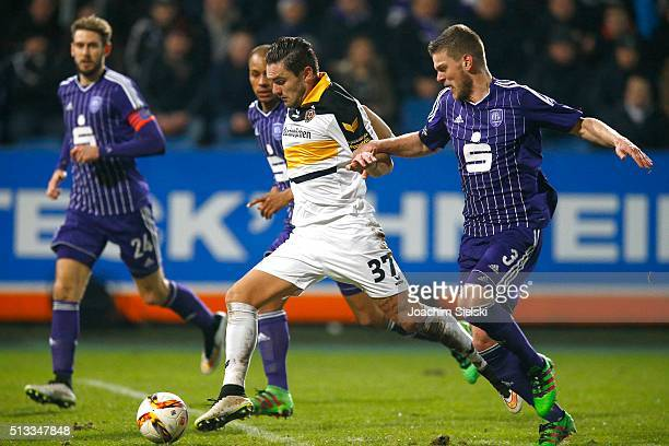 Anthony Syhre of Osnabrueck challenges the Pascal Testroet of Dresden during the third league match between VfL Osnabrueck and Dynamo Dresden at...