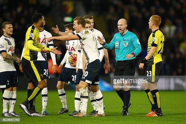 Anthony Taylor intervenes players after Nathan Ake of Watford fouled Erik Lamela of Tottenham Hotspur during the Barclays Premier League match...