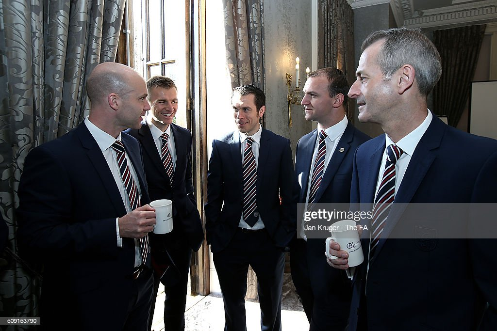 Anthony Taylor,Michael Salisbury, Lee Betts, Robert Madley and <a gi-track='captionPersonalityLinkClicked' href=/galleries/search?phrase=Martin+Atkinson&family=editorial&specificpeople=703318 ng-click='$event.stopPropagation()'>Martin Atkinson</a> chat during the FIFA Referees meeting 2016 at Oulton Hall on February 9, 2016 in Leeds, England.