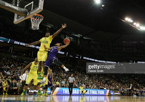 Anthony Thompson of the Holy Cross Crusaders attempts to shoot against Jordan Bell of the Oregon Ducks in the first half during the first round of...