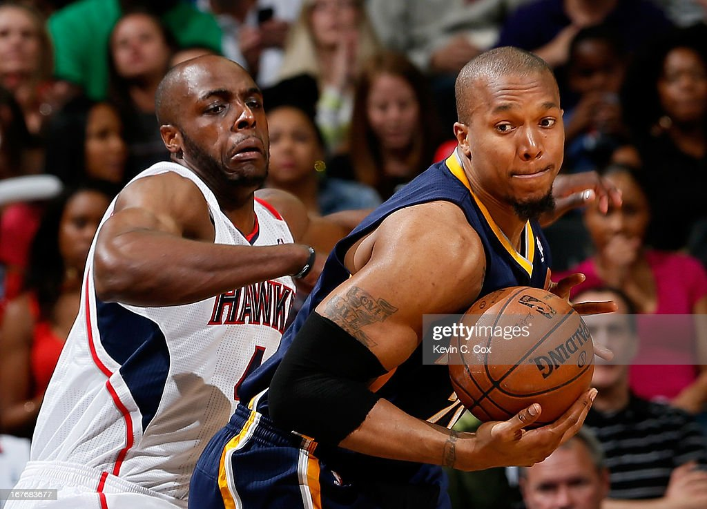 Anthony Tolliver #4 of the Atlanta Hawks defends against David West #21 of the Indiana Pacers during Game Three of the Eastern Conference Quarterfinals of the 2013 NBA Playoffs at Philips Arena on April 27, 2013 in Atlanta, Georgia.