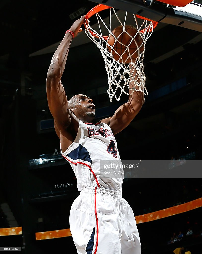 Anthony Tolliver #4 of the Atlanta Hawks dunks against the Orlando Magic at Philips Arena on March 30, 2013 in Atlanta, Georgia.