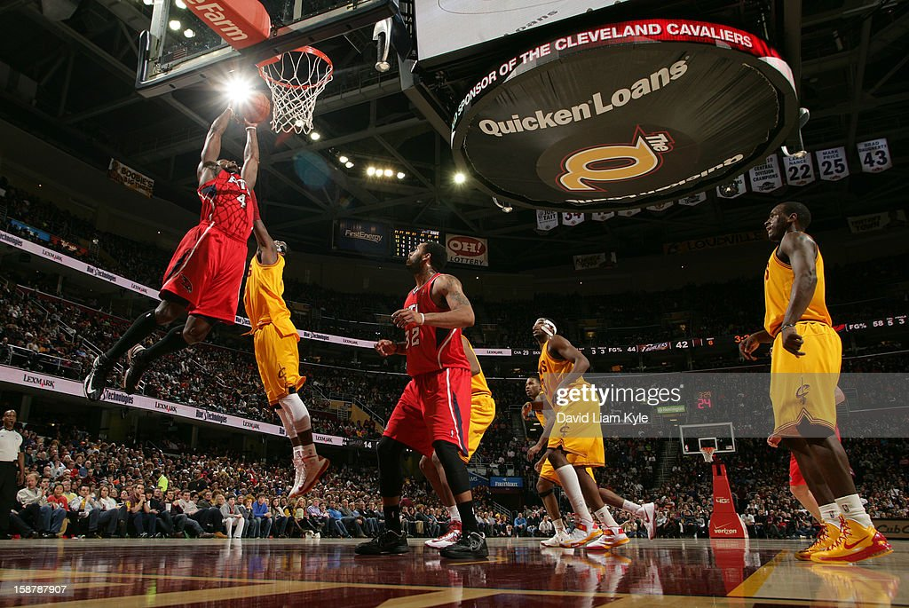 Anthony Tolliver #4 of the Atlanta Hawks goes up for the shot against Kyrie Irving #2 of the Cleveland Cavaliers at The Quicken Loans Arena on December 28, 2012 in Cleveland, Ohio.