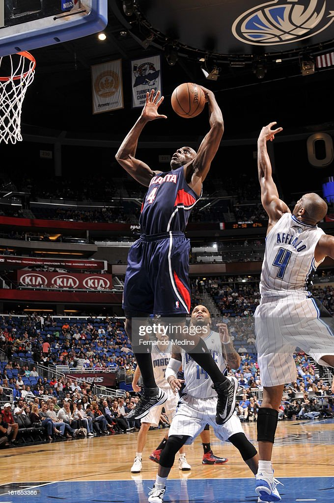 Anthony Tolliver #4 of the Atlanta Hawks grabs the rebound against the Orlando Magic during the game on February 13, 2013 at Amway Center in Orlando, Florida.