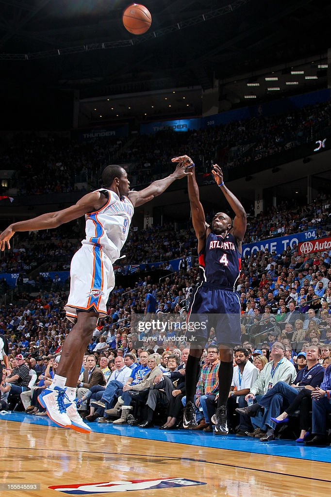 Anthony Tolliver #4 of the Atlanta Hawks shoots a three-pointer against Serge Ibaka #9 of the Oklahoma City Thunder on November 4, 2012 at the Chesapeake Energy Arena in Oklahoma City, Oklahoma.