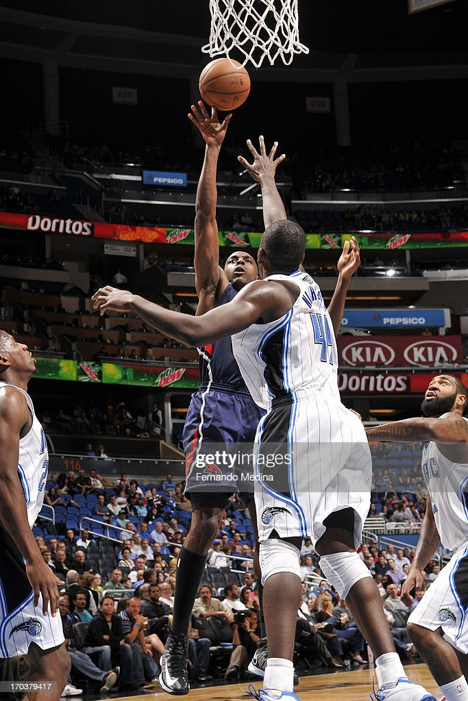 Anthony Tolliver #4 of the Atlanta Hawks shoots against Andrew Nicholson #44 of the Orlando Magic on February 13, 2013 at Amway Center in Orlando, Florida.