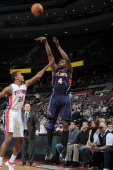 Anthony Tolliver of the Atlanta Hawks shoots the ball against Kim English of the Detroit Pistons during the game between the Detroit Pistons and the...