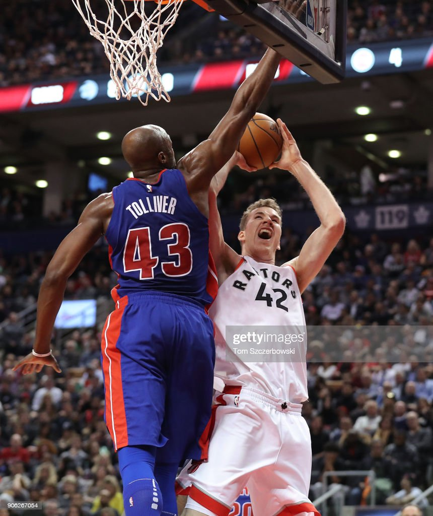 Anthony Tolliver #43 of the Detroit Pistons blocks a shot by Jakob Poeltl #42 of Toronto Raptors at Air Canada Centre on January 17, 2018 in Toronto, Canada.