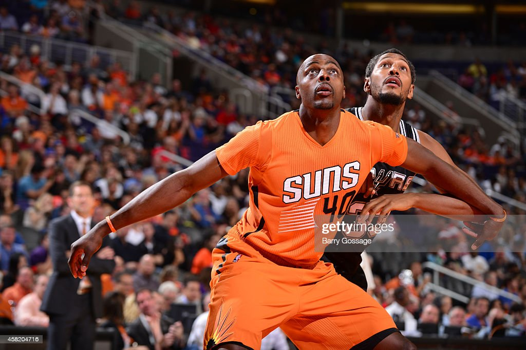 Anthony Tolliver of the Phoenix Suns battles for position with Boris Diaw of the San Antonio Spurs on October 31 2014 at US Airways Center in Phoenix...