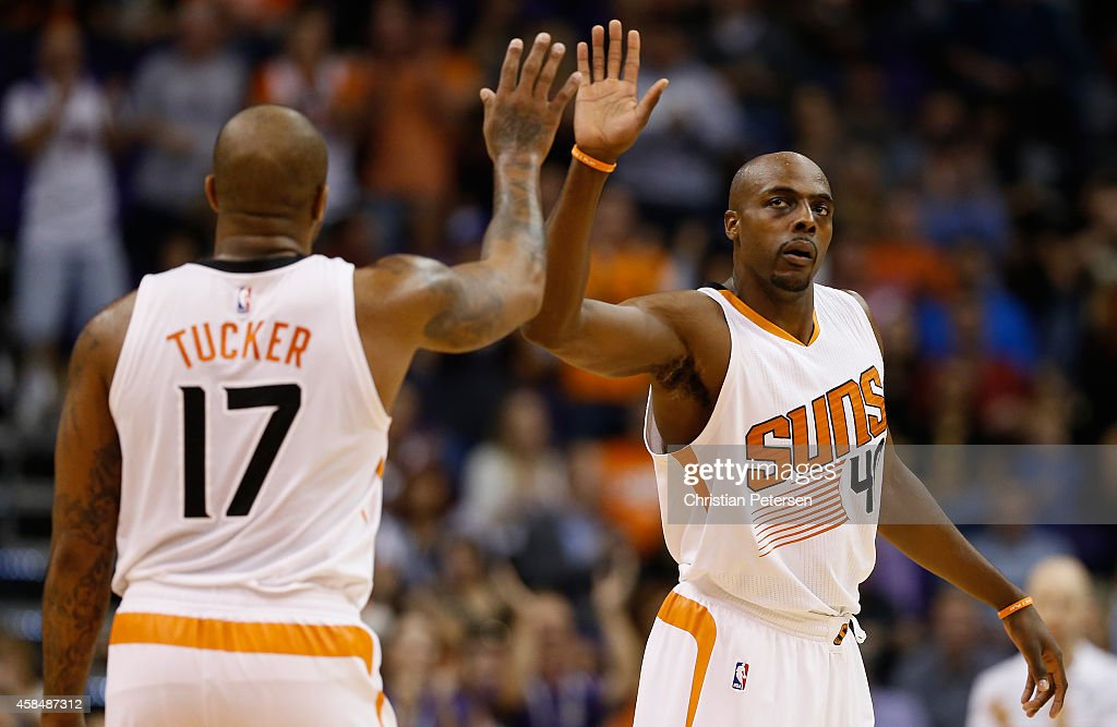Anthony Tolliver of the Phoenix Suns highfives PJ Tucker after scoring against the Memphis Grizzlies during the NBA game at US Airways Center on...
