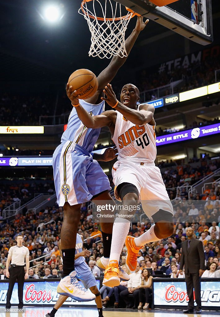 Anthony Tolliver of the Phoenix Suns lays up a shot against the Denver Nuggets during the second half of the NBA game at US Airways Center on...