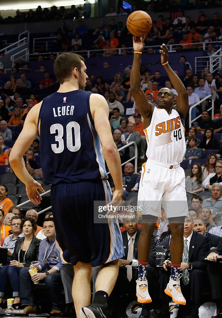 Anthony Tolliver of the Phoenix Suns puts up a shot over Jon Leuer of the Memphis Grizzlies during the first half of the NBA game at US Airways...