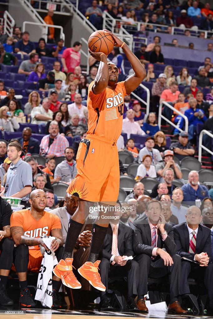 Anthony Tolliver of the Phoenix Suns shoots against the Detroit Pistons during the game on December 12 2014 at US Airways Center in Phoenix Arizona...