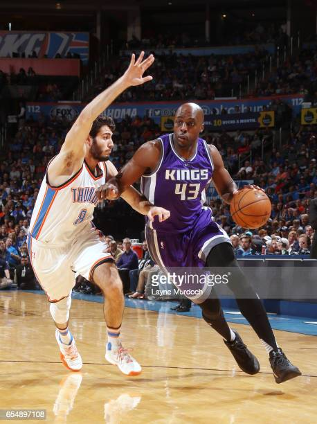 Anthony Tolliver of the Sacramento Kings handles the ball against Alex Abrines of the Oklahoma City Thunder during the game on March 18 2017 at...